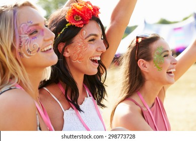 Three girl friends at a music festival