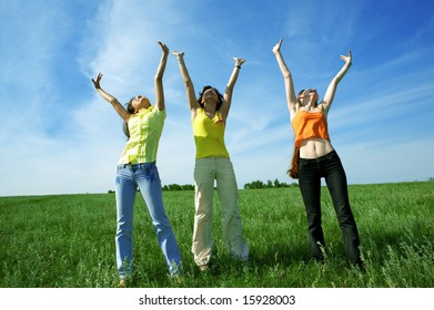 three girlfriend in green field under blue sky