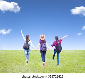 three girls enjoy vacation and tourism with cloud background