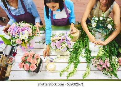 Three girls florist working with flowers