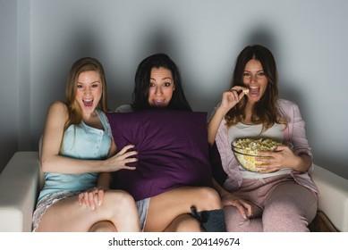 Three girls get scared at TV movie
