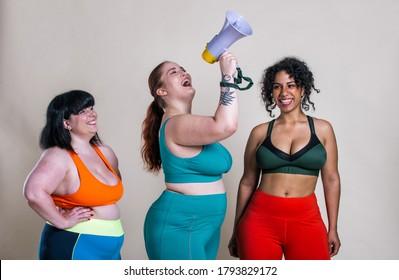 Three girls making sport and having fun
