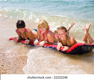 Three girls on seashore