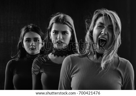 Three Girls Pose In Front Of Black Wall The Emotion Anger Innocence And