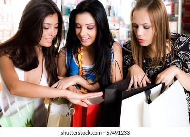 Three girls are  shopping