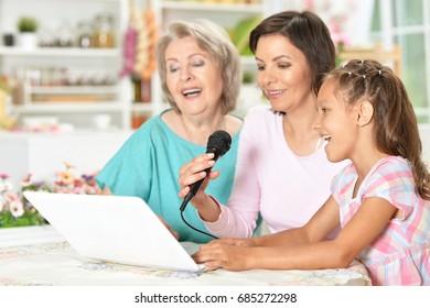 Three girls sing