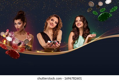 Three girls in smart dresses, jewelry. They holding chips, some of them flying, posing on blue background. Copy space for your text. Poker, casino