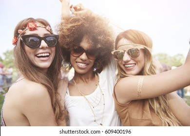 Three of girls spending time together in festival