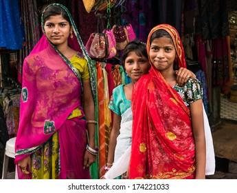 Three girls in the streets of Pushkar, India. Pushkar, India circa May 2013.