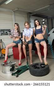 Three girls for tire. car repair