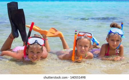 Three girls in the tropical sea