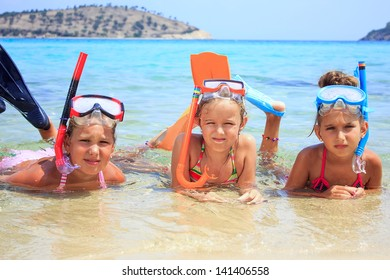 Three girls in the tropical sea