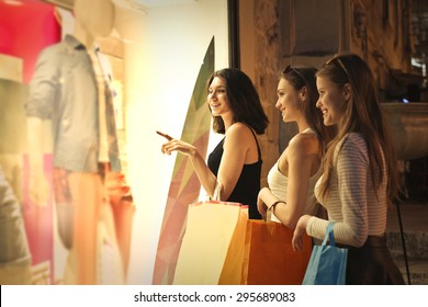 Three girls window shopping together