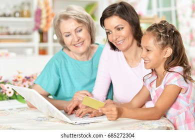 Three girls are working at the computer