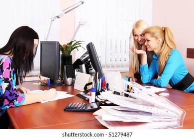 Three girls working in the office
