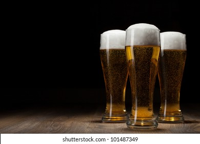 three glass beer on wooden table