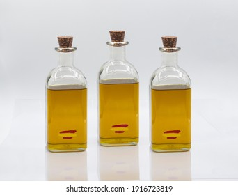 THREE GLASS BOTTLES WITH EXTRA SPANISH VIRGIN OLIVE OIL WITH CORK STOPPER. Extra Virgin Olive Oil has a large number of elements that help us prevent a large number of diseases