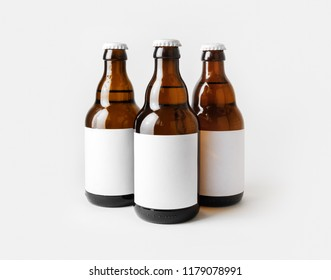 Three glass brown beer bottles with with blank labels.