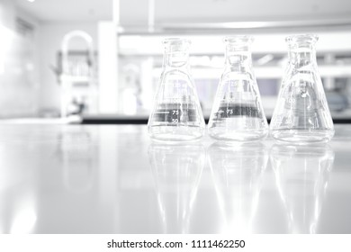 three glass flask in white clean research chemistry science laboratory background