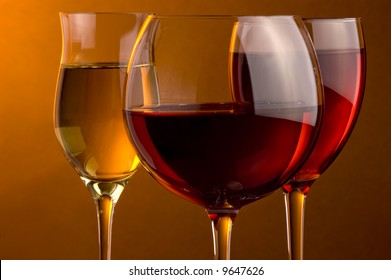 three glass of red, rose and white