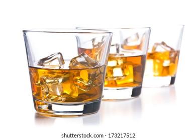 three glass of whiskey on white background