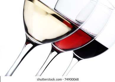 Three glass of wine isolated over white background