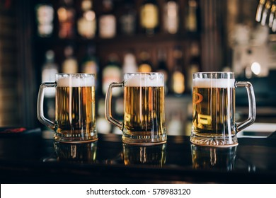 Three glasses with beers in a pub