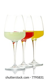 Three glasses with beverages, reflected on white background. Shallow DOF
