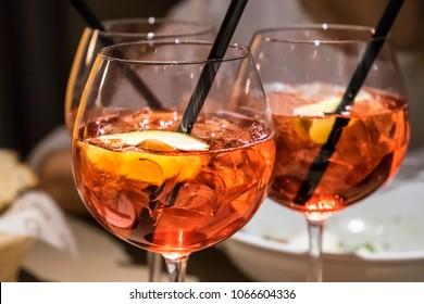 Three glasses of campari orange on the table