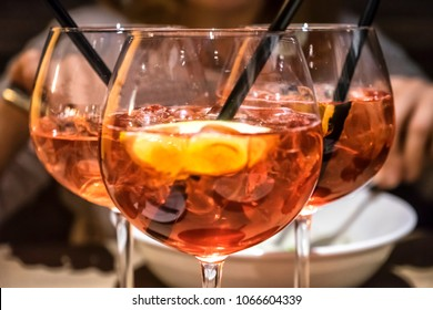 Three glasses of campari orange on the table