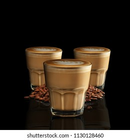 Three glasses of Cappuccino isolated on black