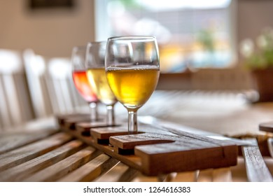 Three glasses of Cider in a wood table in Norway