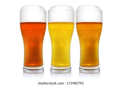 Three glasses with different beers on a white background