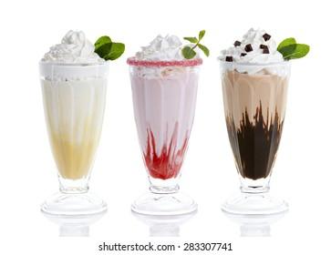 Three glasses of milkshakes, bananashake, chocolateshake and fruiteshake cocktails
