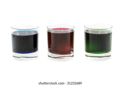 Three glasses with multi-coloured cocktails