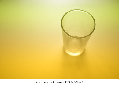 three glasses over yellow background color