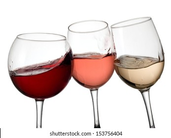 Three glasses with red, white and rose wine plash