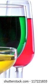 three glasses of red yellow lined green, isolated on gray background