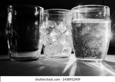 Three glasses representing three states of matter. Liquid, gas and solid.