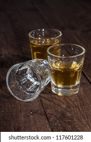 Three Glasses of Rum on wooden background