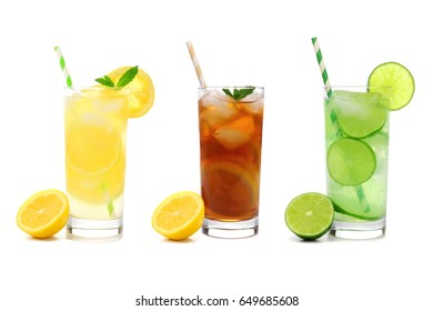 Three glasses of summer lemonade, iced tea, and limeade drinks with straws isolated on a white background