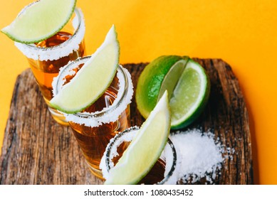 three glasses of tequila and pieces of lime