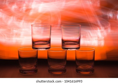 Three glasses under vsiki with an interesting beautiful color in the background