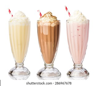 Three glasses of various milkshakes (chocolate, strawberry and vanilla) isolated on white background