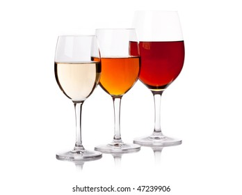 Three glasses with wine of different colour