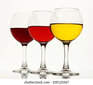 three glasses of wine isolated on white