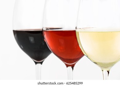 Three glasses of wine with white wine, rose and red on a white background