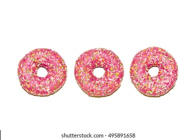Three  glazed strawberry donuts on white background, top view
