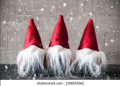 Three Gnomes With Red Hat, Cement, Snowflakes