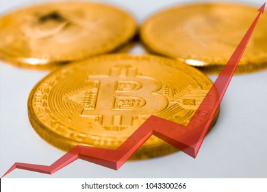 three gold coins bitcoins, a red arrow tends upwards